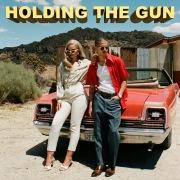 Holding The Gun